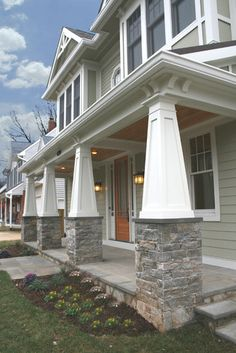 Love the front porch! craftsman tapered columns with stone, cornices, no railing, bluestone porch, green siding with stone veneer Anthony Street House - Robert Nehrebecky Craftsman Columns, Craftsman Style Exterior, Craftsman Porch, Craftsman Bungalows, Exterior House Colors, Exterior Design, Exterior Siding, Stone Veneer Exterior, Craftsman Houses