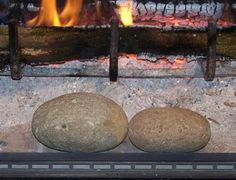 Warm a rock and put it in a sock. Place it in your sleeping bag to keep your feet nice and toasty.