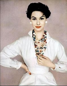 1954 Nancy Berg is wearing white Claire McCardell dress with two strands of homemade beads, photo by Francesco Scavullo