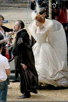 Geoffery Rush as Sir Wasingham and Cate Blanchett as Elizabeth