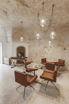 The caves of Matera, also known as sassi, arelocated in southern Italy and have been used since Paleolithic times, when inhabitants began carving out the soft stone to create homes. Tasked with the challenge of creating a warm, inviting interior with a modern feel, local architecture firm Manca Studio, run by brother-sister duo Alfredo and Marina,expertly blended the historic and contemporary for the La Dimora di Metello Hotel. In their first hotel project, they have embraced the curves of…