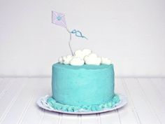 Red Velvet Layer Cake, with blue icing, marshmallow clouds and kite cake topper! This is precious and looks pretty easy to make!
