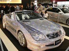 Mercedes SL, spotted at an auto show overseas. From a distance, it almost  appears that the car is coated in glitter, but it is actually covered in diamonds.
