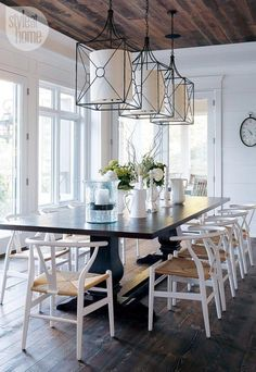 white wishbone chairs with dark table/floor