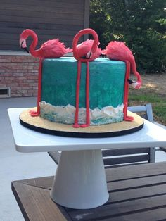 Flamingo cake. The flamingos are made out of gumpaste. The sand is brown sugar and the rest is buttercream. It was inspired by a cake I found through Pinterest