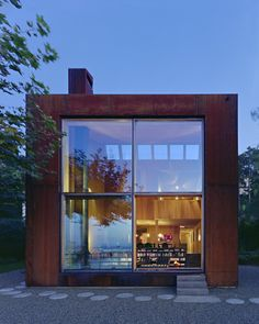 A Sculptural Steel Abode on Lake Geneva Is Up For Auction #forsale #realestate #steelhome