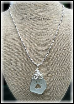 Sea Glass Paw Print Cut Out Necklace, $34.00