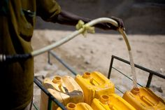"""In many places in Africa where there is no running water, it has to be delivered in jerrycans, be it on the back of old woman, or on a cart pulled by donkey. The plastic jerrycans are relatively recent thing, a blessing which is way cheaper and durable than old clay pots, and along with other cheap Chinese plastic goods, changed African daily life forever. Berbera, Somaliland."" Clay Pots, Hand Washing, Donkey, Old Women, Blessing, Cart, Chinese, African, Plastic"