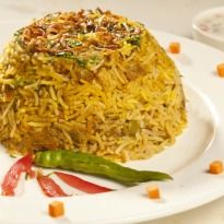 Makhni Paneer Biryani Recipe - Fried paneer cubes doused in a creamy gravy, layered with rice and cooked 'dum' style.