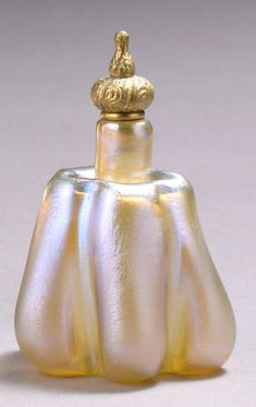 A Tiffany Studios Favrile glass and gilt-bronze perfume bottle