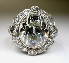 Amazing Edwardian Platinum ring, center old mine cut diamond, 22 accent diamonds old min cut equaling all together! Antique Diamond Rings, Antique Engagement Rings, Diamond Engagement Rings, Edwardian Jewelry, Antique Jewelry, Vintage Jewelry, Beautiful Rings, Fine Jewelry, Bling