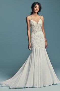 Mermaid Wedding dress by Maggie Sottero IMANI. Embroidered lace motifs pearls and crystals chic boho wedding dress featuring a sheer bodice. Beaded spaghetti straps sweetheart neckline illusion back embellished in lace motifs. Fit-and-flare chiffon skirt. Pink Wedding Guest Dresses, Fit And Flare Wedding Dress, Elegant Wedding Dress, Perfect Wedding Dress, Bridal Dresses, Dresses Dresses, Beaded Wedding Dresses, Wedding Dresses With Straps, Shear Wedding Dress