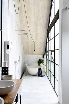 One of the most popular interior design for home is modern. The modern interior will make your home looks elegant and also amazing because of its natural material. If you want to design your home inte White Bathroom, Bathroom Interior, Modern Bathroom, Loft Bathroom, Industrial Bathroom, Bathroom Taps, Narrow Bathroom, Minimalist Bathroom, Small Bathrooms