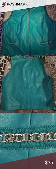 """👗BIG SALE Faux leather turquoise embellished vest This is a gorgeous color! Like new condition but when I got it it was too big. Marked as a 12 women's but fits bigger. Maybe 14/16? Has silver chain links as accents around collar, faux pockets and bottom hem. 60% pu, 40% cotton. Has clean, thin lining. Measures 22"""" length from top of shoulder to bottom hem, 20"""" from armpit to armpit of vest, 20.5"""" from around waist (just above pockets). Please go by measurements. Jackets & Coats Vests"""