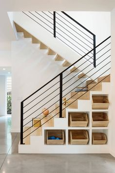 Staircase, Wood Tread, and Metal Railing Clever cubby storage is incorporated into the base of the interior stairs, while the extra-deep stair treads provide flexible stadium-style seating for the kids.