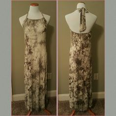 NWOT Love Stitch  tie-dyed Maxi Dress Beautiful Love Stitch tie-dyed Maxi Dress. Ina gray and muted army green. It is slightly adjustable due to tie at neck. As currently tied the length measures at 55 inches from neck to hem.  Fabric Content: 100% Rayon Love Stitch Dresses Maxi
