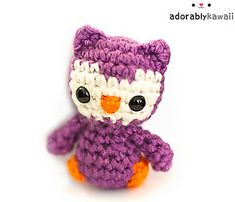 Pattern includes written instructions, photo tutorial for magic ring & color changes, and modifications to make a penguin. PDF has 7 pages.