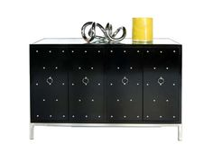 Black lacquer nickel studded buffet with inset beveled mirror top. One fixed interior shelf.