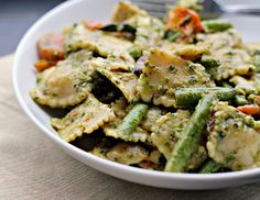 pesto pasta salad with roasted asparagus, string beans, cherry tomatoes and olives
