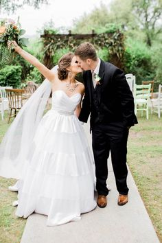 Excited Kiss After Walking Down the Aisle | Honey Gem Creative | http://heyweddinglady.com/preppy-southern-chic-summer-wedding-shoot/