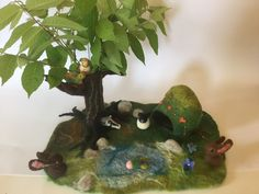 Seasonal, waldorf inspired felted playmat. Put your collected flowers inside the hollow trunk.