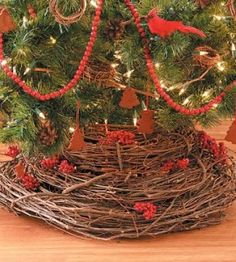 Grapevine Wreaths make a rustic tree skirt for a nature-themed tree.