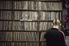 Jeff Grotte looks through albums at Treehouse Records