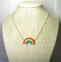 BLACK FRIDAY SALE rainbow necklace - rainbow jewelry - rainbow pendant - rainbow - glitter - glitter necklace - red turquoise yellow - wiza. $6.40, via Etsy.