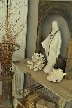 Holy Moly!  Love the cleaver use of an old iron fireplace surround.  Mary's never looked more beautiful.♥