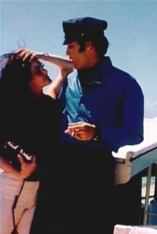 Elvis and Priscilla on the new boat he purchased in Hawaii while on vacation in 1968.