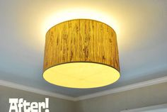 make an ugly ceiling light cool w/ a lampshade.  Also saw a program where they mounted 2 lampshades on a piece of wood and hung that from the ceiling.  Super cool
