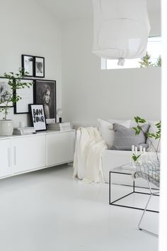 Display in the sitting room in the beautiful monochrome Norwegian home of Elisabeth Heier in summer time.