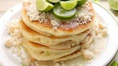 These pretty little pancakes get a kick from key lime zest, a smidgen of white chocolate chips. As if that wasn't enough, they're also topped with a buttery streusel and homemade Coconut Syrup. Amaze!
