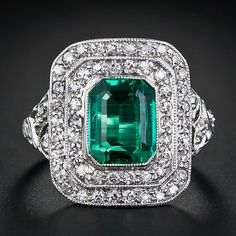 1.85 Carat Art Deco Emerald and Diamond Ring, via @LangAntiques. A rare beauty! A gorgeous bight green crystal, and virtually eye-clean, old-mine Colombian emerald shines forth from this classic original Art Deco mounting, finely handcrafted in platinum, circa 1920. The gemmy emerald is framed in a stepped double row of tiny bright-white sparkling diamonds totaling one-carat, and the shoulders are adorned with graceful open work.