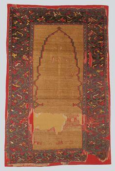 Beautiful central Anatolian prayer rug, 17th century, courtesy TIEM Istanbul, inv. no, 354, from the Sultan Alaaddin Keykubat Tomb in Konya. Note the unusual prayer arch shape and the palin field similar to an unusual prayer rug in the V&A Museum in London.