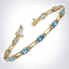 Aquamarine and diamond tennis bracelet by HadarDiamonds.com . Perfect for a March birthday.  Set in yellow gold.  Also available in white gold or platinum.  #diamondbracelet #aquamarinebracelet