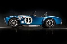1964 Shelby Cobra USRRC Roadster - ex-Shelby Team Car; one of six 1964 USRRC cars and one of two with dual side pipes on each side of car; competed in 1964 FIA Bridgehampton race and 1966 SCCA A/Production; currently restored to its original Shelby team appearance in Guardsman Blue with white Le Mans stripes.