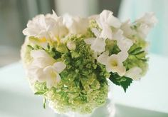 Fresh blooms by The Fleuriste. Photo by Candi Coffman Photography. #wedding #centerpiece #green #white
