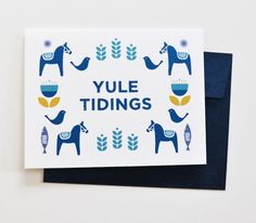 Scandinavian-inspired holiday card Cheerful patterned holiday card with cute Scandinavian-inspired illustrations of dala horses, modern flowers, fish, and foliage, in a cool palette of blue, yellow, a