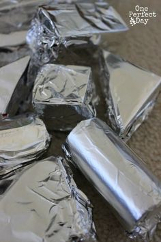 Wrapping blocks with foil ≈≈// Kids love this. Exploration of shiny and dull.