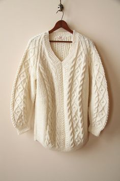 Cable Sweater. I have something like this in yellow, was my mom's in the 80's and I wear it all the time! :P