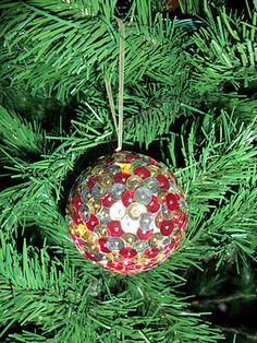 sequin ornament - styrofoam ball, sequins, straight pins, and ribbon
