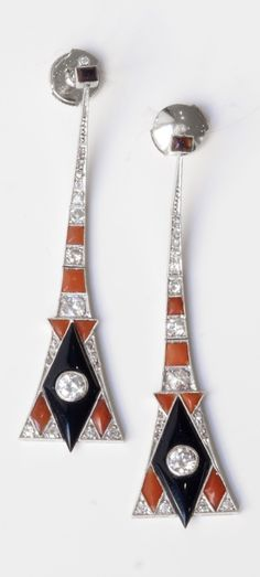 A pair of Art Deco platinum, diamond, onyx and coral ear pendants, circa 1920. #ArtDeco