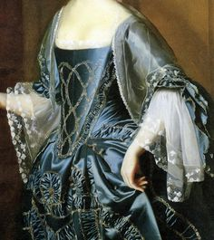 Blue satin silk gown with gold polychrome thread embroidery to stomacher and petticoat, ruched trimming and gold embroidery to gown, white gauze shawl draped over shoulders, long two tiered gauze ruffles with delicate embroidered edge at elbow. Mrs. Daniel Sargent (Mary Turner Sargent), 1763, John Singleton Copley.