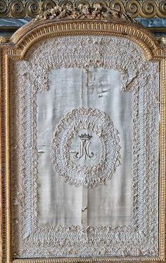 Marie Antoinette's monogram delicately embroidered on a shield at Versailles ©2013 Blossomgraphicdesign.com