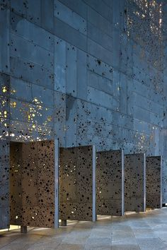 Façade: Perforated aluminum panels wrapped with moss, lichen and other plant species that will eventually come to surround the entire building | Expansion of the Museum of San Telmo | Nieto Sobejano Architects
