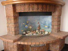 finto acquario, i pesci sono fatti modellando e carteggiando scarti di isolante x tetti