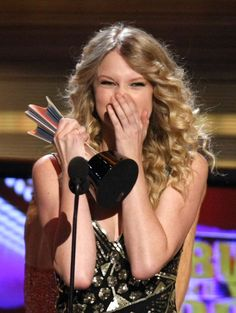 Pin for Later: Surprise — It's Taylor Swift's Birthday!  She covered her face while accepting her album of the year award at the Academy of Country Music Awards in April 2009.