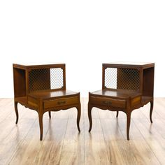 This pair of step tables are featured in a solid wood with a glossy cherry finish and a wire mesh panel. These end tables have 2 shelf tiers with a leather top, an interior cubby cabinet and 1 drawer. Perfect side tables for storing magazines and books! #americantraditional #tables #endtable #sandiegovintage #vintagefurniture