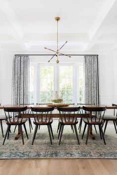 Amber Lewis of Amber Interiors / oriental rug, windsor chairs, brass sputnik chandelier